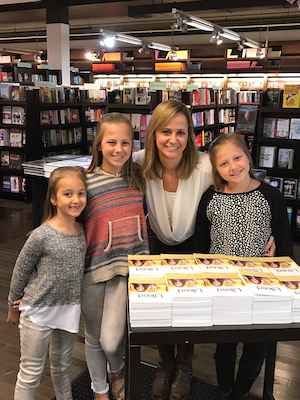 Kari Kampakis and her daughters with copies of Liked.