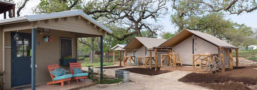 Examples of homes from the Community First! RV park, which features RVs and micro-homes for the chronically homeless in the Austin, Texas area.