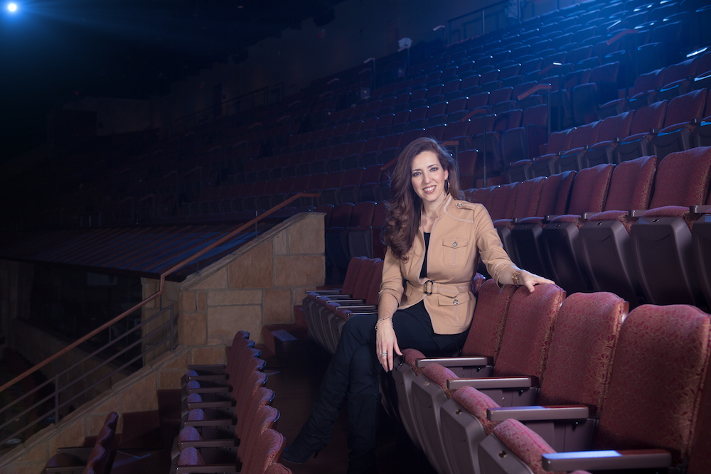 Maria-Jose Tennison sits in the Sight and Sound Theater.