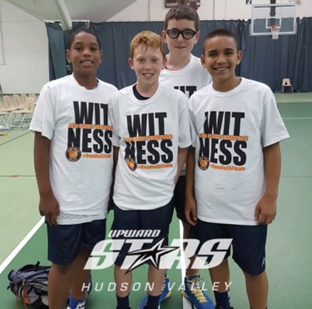 Four boys in the Upward Stars of Hudson Valley program pose for a photo.