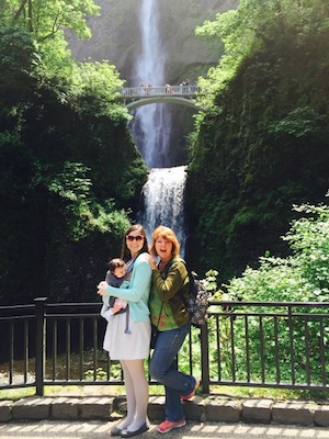 Cheryl Karpen poses with family in front of a waterfall.