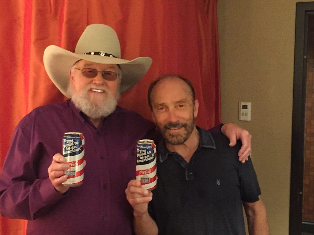 Lee Greenwood and Charlie Daniels posing for a picture together.