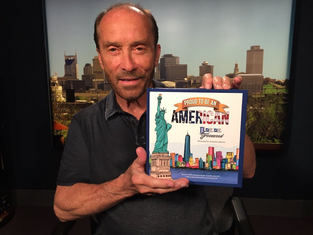 Lee Greenwood with his book, Proud to be an American.