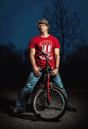 Jamie Blaine posing with a bicycle.