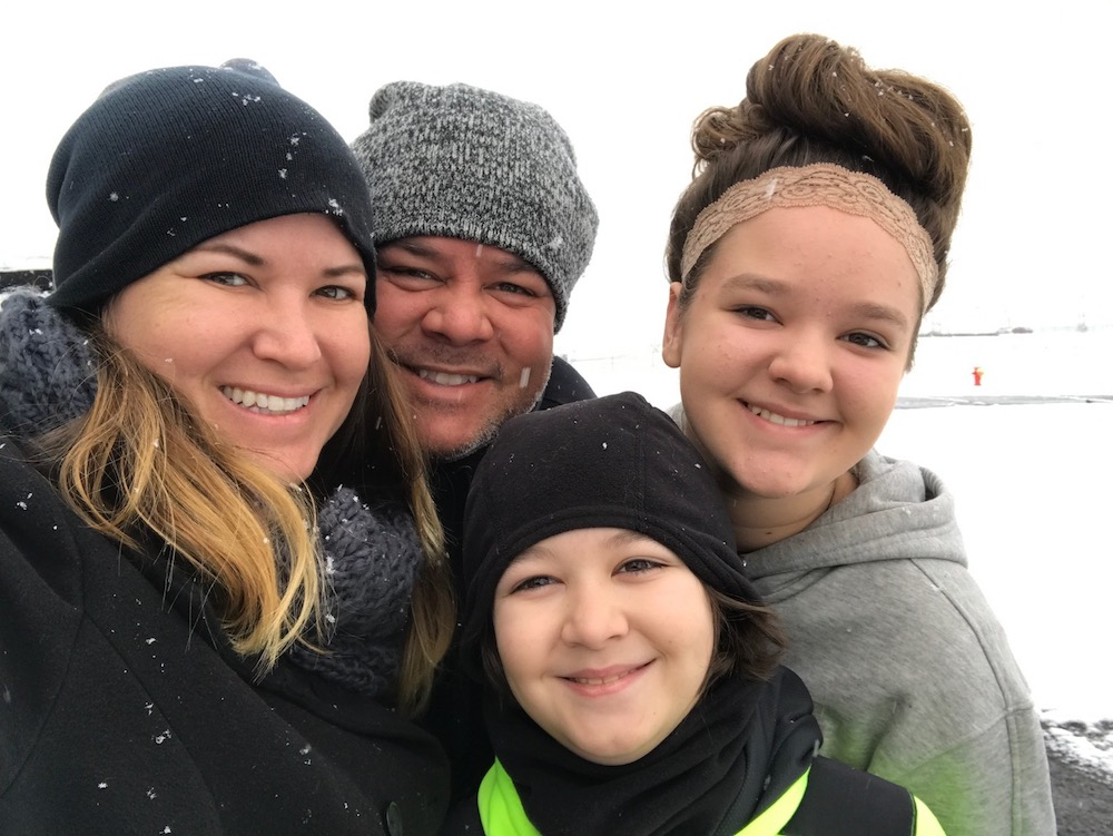 Sami Cone with her family in the winter