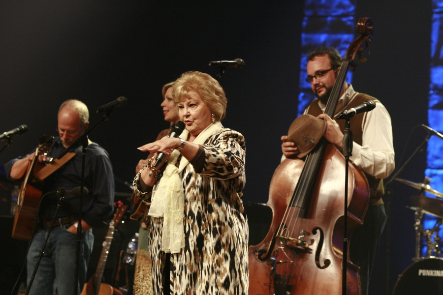 Gloria Gaithers performing on stage.