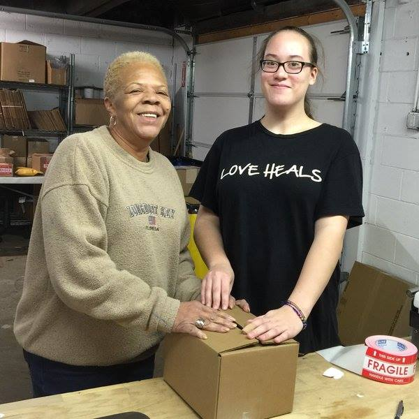 Brenda Wilson working with volunteers at Thistle Farms.