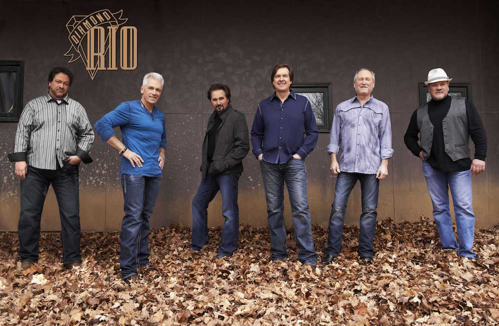 The members of Diamond Rio standing in some leaves.