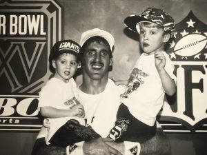 Winning photo of Super Bowl Champion quarterback, Jeff Hostetler and his children