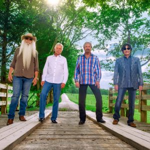 The Oak Ridge Boys press image on a bridge