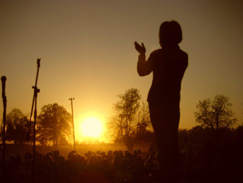 Silhouette of Susie McEntire Eaton singing at the rodeo