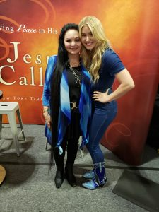 Crystal Gayle and Harper Grace meet at the Jesus Calling booth at CMA Fest 2019